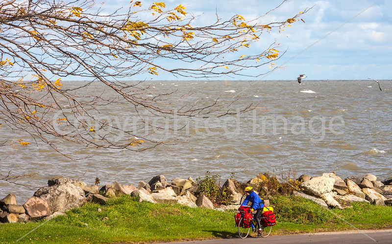 Touring cyclist along Lake Erie