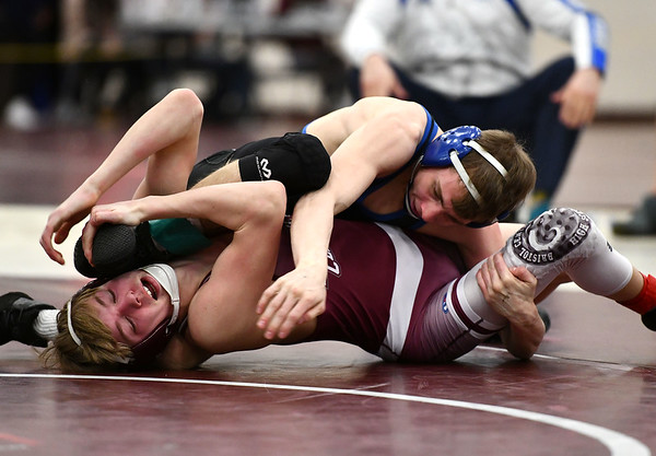 2/22/2020 Mike Orazzi | StaffrBristol Eastern's Trent Thompson and Bristol Central's William Hamilton in a 106 pound match during the Class L State Wrestling Tournament held at Bristol Central High School on Saturday.