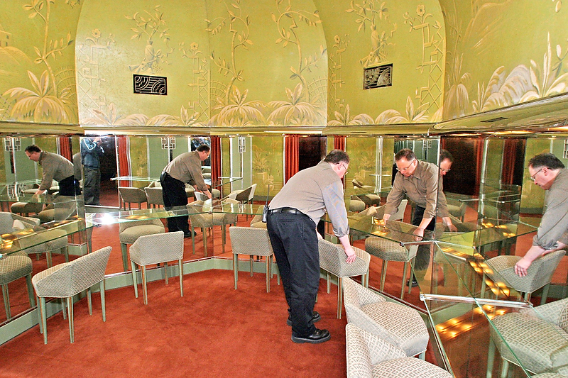. Jeff Ewald, the operations manager at the Paramount Theatre in Oakland, straightens up  the women\'s restroom. The theater\'s restrooms each feature a foyer and a sitting room in addition to stalls and sinks. (Akim Aginsky/Bay Area News Group Staff Archives)