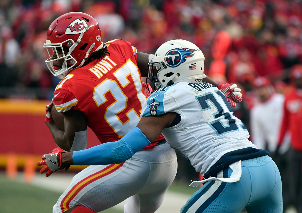 . Tennessee Titans safety Kevin Byard (31) tackles Kansas City Chiefs running back Kareem Hunt (27) during the first half of an NFL wild-card playoff football game, in Kansas City, Mo., Saturday, Jan. 6, 2018. (AP Photo/Ed Zurga)