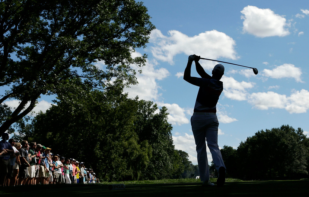 . Henrik Stenson, of Sweden, watches his tee shot on the eighth hole during the third round of the PGA Championship golf tournament at Oak Hill Country Club, Saturday, Aug. 10, 2013, in Pittsford, N.Y. (AP Photo/Charlie Riedel)