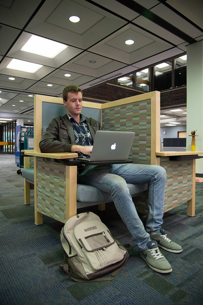Casey Packard works on an assignment in the Mary and Jeff Bell Library.