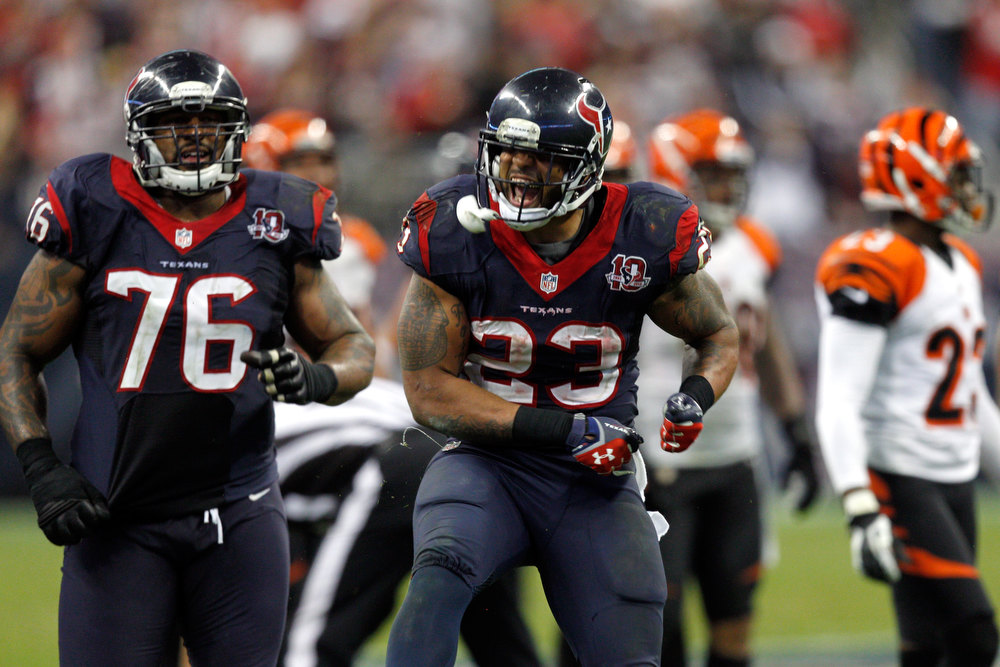 Description of . Arian Foster #23 of the Houston Texans celebrates against the Cincinnati Bengals during their AFC Wild Card Playoff Game at Reliant Stadium on January 5, 2013 in Houston, Texas.  (Photo by Bob Levey/Getty Images)