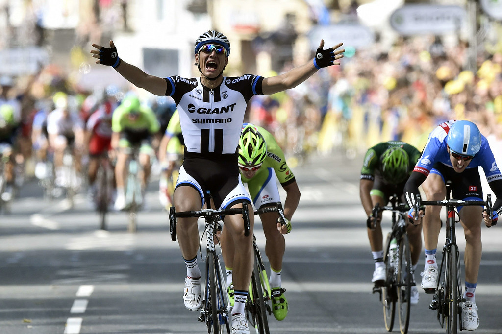 . Germany\'s Marcel Kittel (L) celebrates as he crosses the finish line ahead of Slovakia\'s Peter Sagan (C), Lithuania\'s Ramunas Navardauskas (R), and France\'s Bryan Coquard (2ndR) at the end of the 190.5 km first stage of the 101st edition of the Tour de France cycling race on July 5, 2014 between Leeds and Harrogate, northern England.  The 2014 Tour de France gets underway on July 5 in the streets of Leeds and ends on July 27 down the Champs-Elysees in Paris.  LIONEL BONAVENTURE/AFP/Getty Images