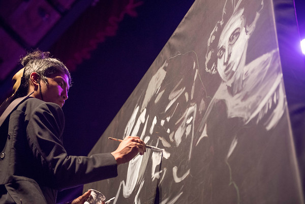 DAVID LIPNOWSKI / WINNIPEG FREE PRESS   Artist Nereo Eugenio II paints as the Winnipeg Symphony Orchestra performs Symphonie Fantastique on Tuesday, October 18, 2016 at the Centennial Concert Hall.