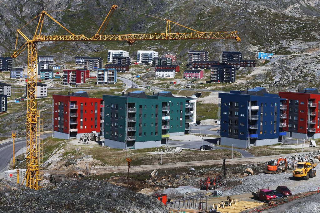 . Constuction cranes are seen as new apartment buildings are built into the mountains on July 29, 2013 in Nuuk, Greenland. (Photo by Joe Raedle/Getty Images)