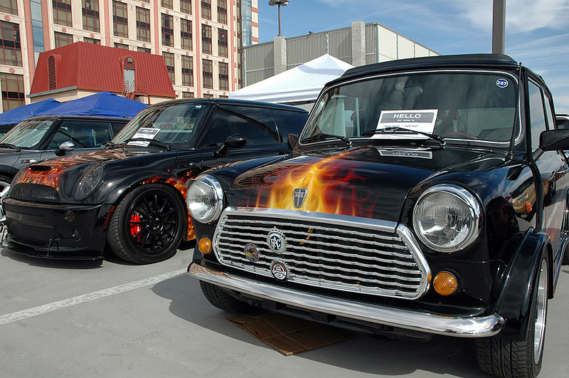 A MINI Cooper S and a Classic Mini in matching flames.