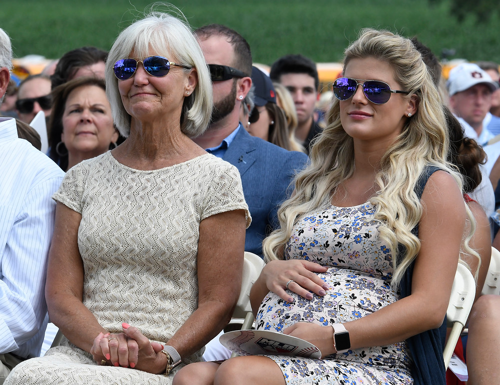 . Chipper Jones\' mother Lynne Jones ,left, and his wife Taylor Jones watch his induction speech on Sunday, July 29, 2018, at the Baseball Hall of Fame Induction in Cooperstown, N.Y. (AP Photo/Hans Pennink)