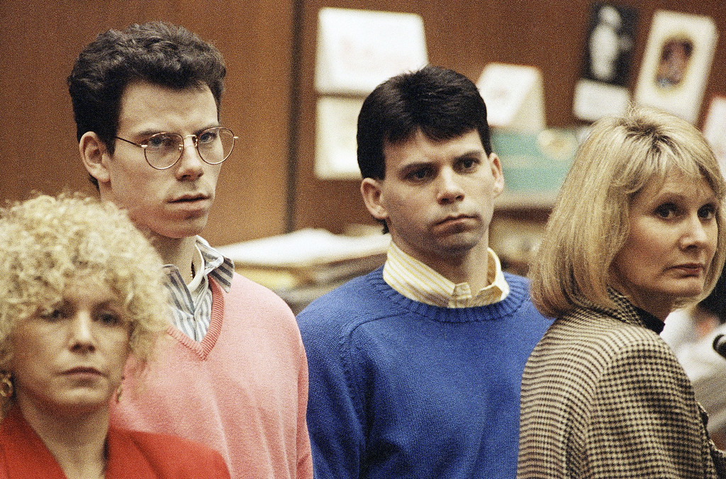 . File - Lyle Menendez, right, and brother Erik listen to a charge of murder conspiracy against them with Leslie Abramson, far left, attorney for Erik, Dec. 29, 1992 in Los Angeles. The brothers pled innocent to the new indictment which dropped the original charge that they killed their parents for money. The indictment was returned nearly three years after Joseph and Kitty Menendez were found slain in their home. (AP Photo/Chris Martinez)