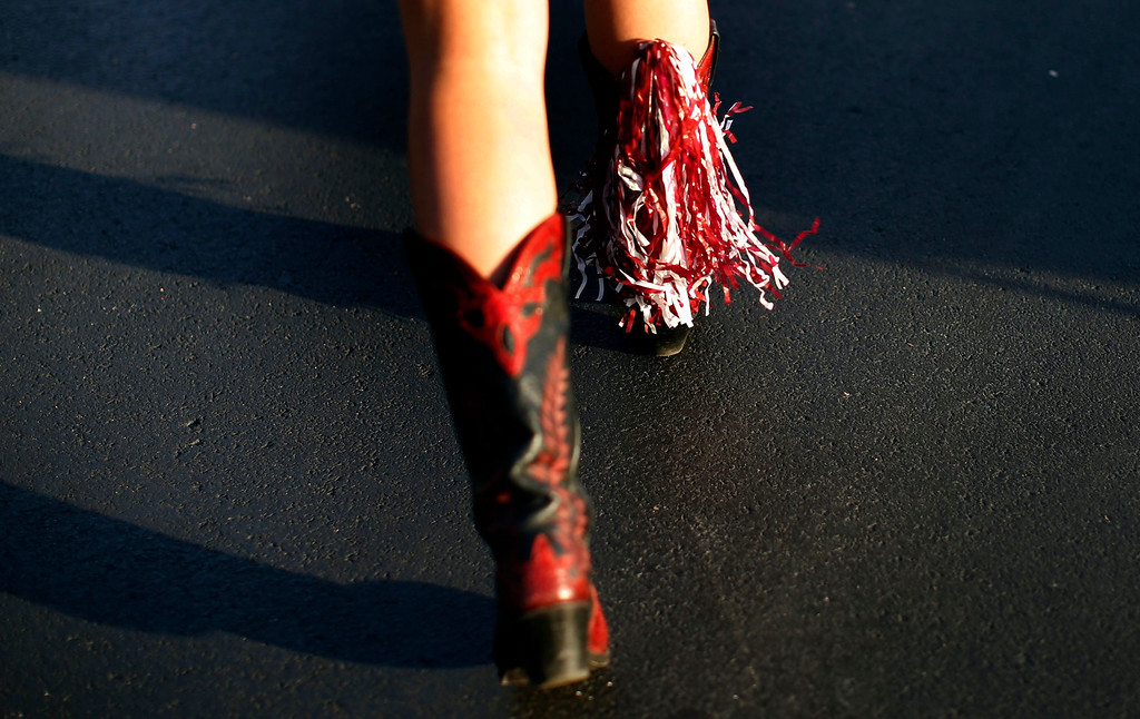 . An Alabama Crimson Tide fan wears tassels on her cowboy boots outside Sun Life stadium before the BCS National Championship college football game between Alabama and the Notre Dame Fighting Irish in Miami, Florida January 7, 2013. REUTERS/Mike Segar