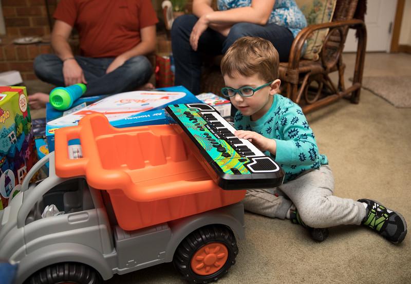 Caleb Playing Keyboard on back of truck.jpg