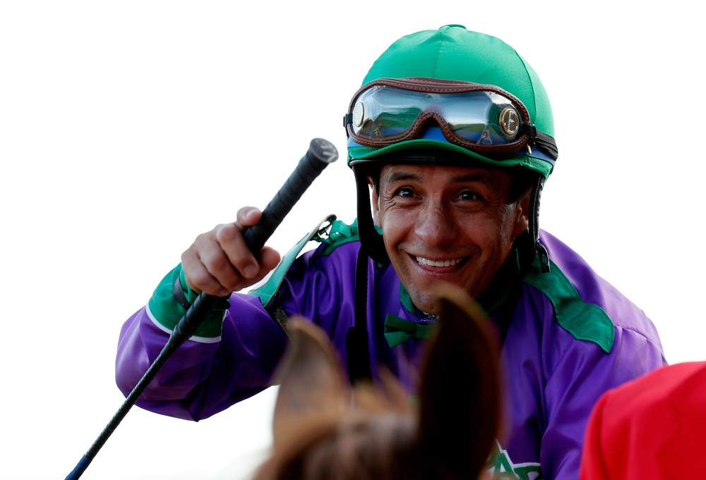 Description of . Jockey Victor Espinoza celebrates atop of California Chrome #5 after crossing the finish line to win the 140th running of the Kentucky Derby at Churchill Downs on May 3, 2014 in Louisville, Kentucky.  (Photo by Kevin C. Cox/Getty Images)