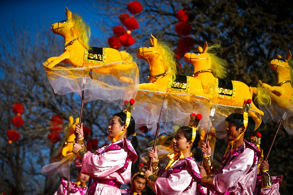 . Performers do the horse dance on the eve of the Lunar New Year, or Spring Festival, at a park fair in Beijing, China, 30 January 2014. The Year of the Horse, according to the symbol of the 12 year cycle of animals, will begin on 31 January.  EPA/DIEGO AZUBEL