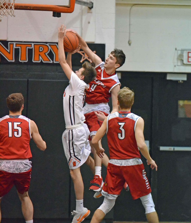 . Paul DiCicco - The News-Herald Action from Mentor-North boys basketball Jan. 16.