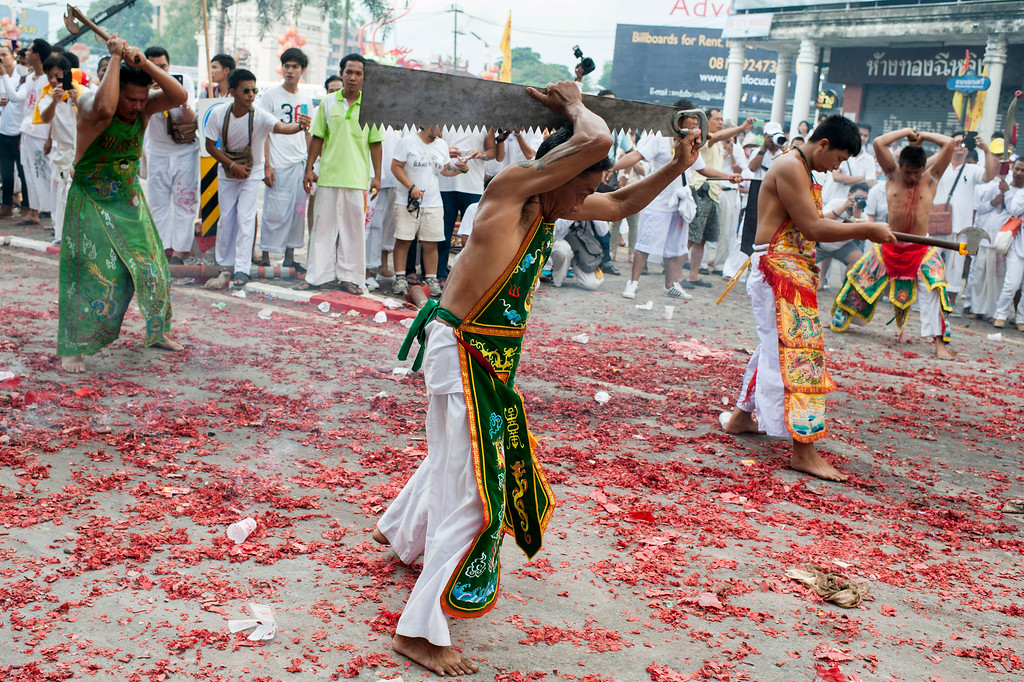 . Vegetarian festival devotees parade through the streets on September 29, 2014 in Phuket, Thailand. Ritual Vegetarianism in Phuket Island traces its roots back to the early 1800\'s.  (Photo by Borja Sanchez-Trillo/Getty Images)