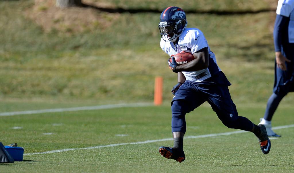 . Denver Broncos running back Montee Ball (28) runs through drills during practice November 20, 2013 at Dove Valley (Photo by John Leyba/The Denver Post)