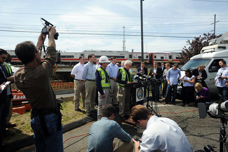 . NTSB member Earl Weener addresses the media at a press conference near the scene of Metro-North train collision, Saturdya, May 18, 2013 in Bridgeport, Conn.  Also on the scene were Congressman Jim Himes, Senator Dick Blumenthal, Senator Chris Murphy and Gov. Dannel Malloy. Officials described a devastating scene of shattered cars and other damage where two trains packed with rush-hour commuters collided in Connecticut, saying Saturday it\'s fortunate that no one was killed and that there weren\'t even more injuries. (AP Photo/The Connecticut Post, Cathy Zuraw)