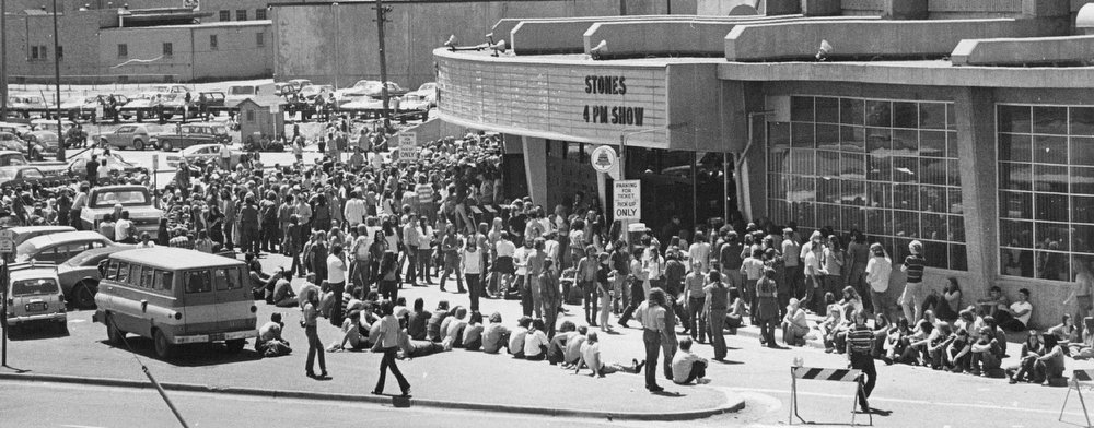 . Several hundred persons are on hand at the Denver Coliseum at noon Sunday to buy tickets for the June 16 Rolling Stones concerts at the Coliseum. According to Barry Fey, promoter of the concerts, about 12,000 persons were at the Coliseum by 8:15 for the tickets that went on sale at 8. About 7,000 of them had spent the night waiting for tickets to go on sale, according to Denver police. The Rolling Stones will give two concerts, at 4 and 9 p.m. June 16. Fey reported that about 5,000 tickets for the concerts were still available Sunday night.;  (Photo By John G. White/The Denver Post)