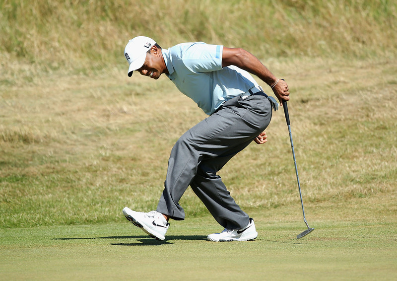. Tiger Woods of the United States reacts after missing a birdie putt on the 9th hole during the second round of the 142nd Open Championship at Muirfield on July 19, 2013 in Gullane, Scotland.  (Photo by Andy Lyons/Getty Images)