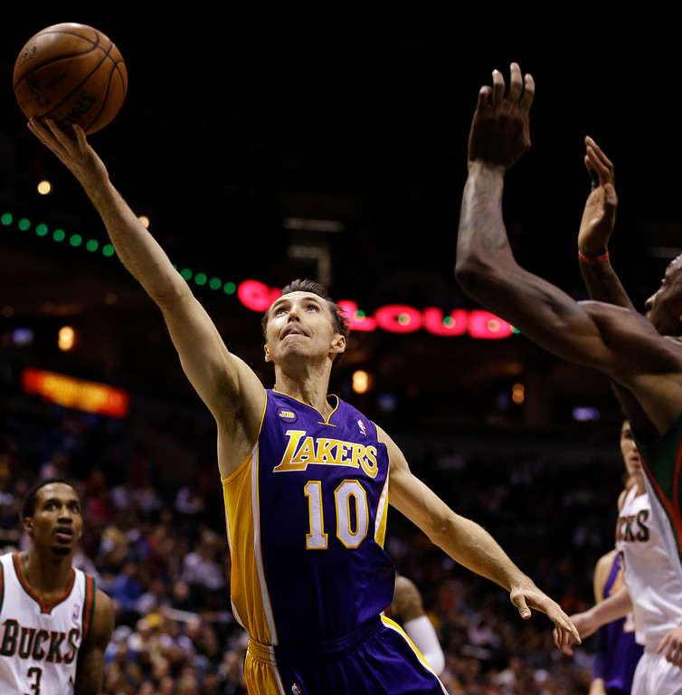 . Los Angeles Lakers\' Steve Nash(10) drives to the basket against the Milwaukee Bucks during the first half of an NBA basketball game, Thursday, March 28, 2013, in Milwaukee. (AP Photo/Jeffrey Phelps)