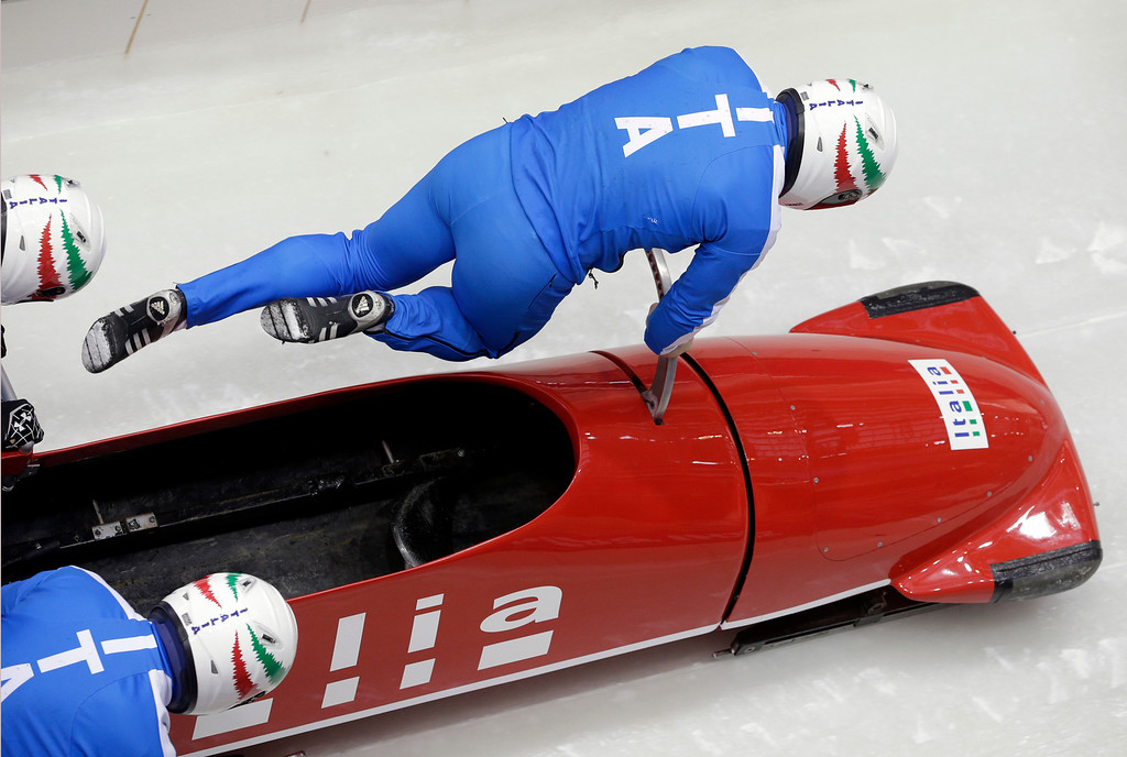 . The team from Italy ITA-1, piloted by Simone Bertazzo, start a run during the men\'s four-man bobsled training at the 2014 Winter Olympics, Wednesday, Feb. 19, 2014, in Krasnaya Polyana, Russia. (AP Photo/Michael Sohn)