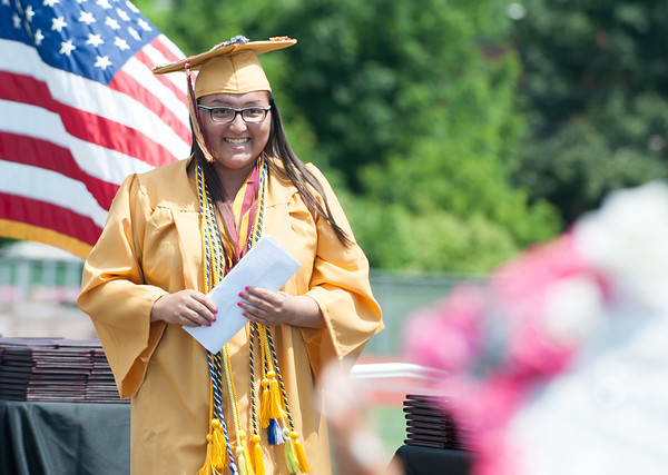 06/19/18 Wesley Bunnell | Staff New Britain High School Valedictorian Gabriella Roy walks off stage after delivering her address during graduation exercises at Veterans' Memorial Stadium at Willow Brook Park on Tuesday morning.
