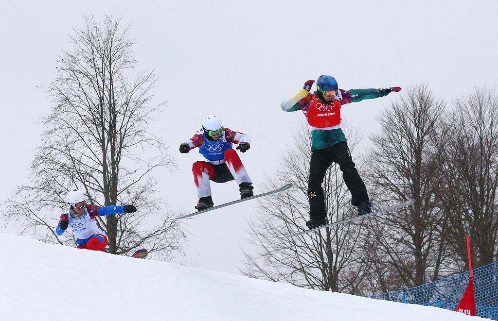 . Alex Pullin of Australia (red bib) and Kevin Hill of Canada (blue bib) compete in the Men\'s Snowboard Cross 1/8 Finals on day eleven of the 2014 Winter Olympics at Rosa Khutor Extreme Park on February 18, 2014 in Sochi, Russia.  (Photo by Cameron Spencer/Getty Images)