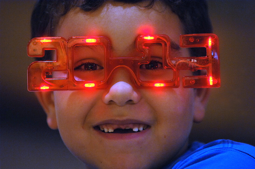 . Evan Spindler, 7, wears 2013 glasses on Monday, Dec. 31, 2012 during the 14th Annual 2013 First Night Scranton New Year\'s Eve festivities in downtown Scranton, Pa. (AP Photo/The Scranton Times-Tribune, Butch Comegys)