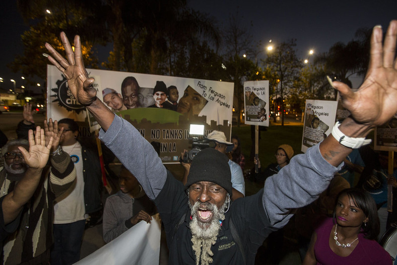 . Demonstrators react after a grand jury decided not to indict a white police officer in the Ferguson, Missouri shooting death of an unarmed black teenager, November 24, 2014 in Los Angeles, Calfornia.  A St. Louis County grand jury has decided to not indict Ferguson police Officer Darren Wilson in the shooting of Michael Brown that sparked riots in Ferguson, Missouri in August.  RINGO CHIU/AFP/Getty Images