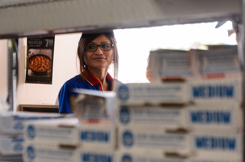 . Thirty-three-year-old Daniela Busald, who is the younger sister of slain Domino\'s Pizza shift manager Nelly Kantun, volunteers at a memorial fundraiser for her sister at Domino\'s Pizza on Highland Avenue in San Bernardino, CA on Wednesday, Feb. 19, 2014. Kantun worked as a Domino\'s employee for more than 20 years, and the pizza location she worked at donated 100 percent of the proceeds earned Wednesday to the memorial fund. (Photo by Rachel Luna / San Bernardino Sun)
