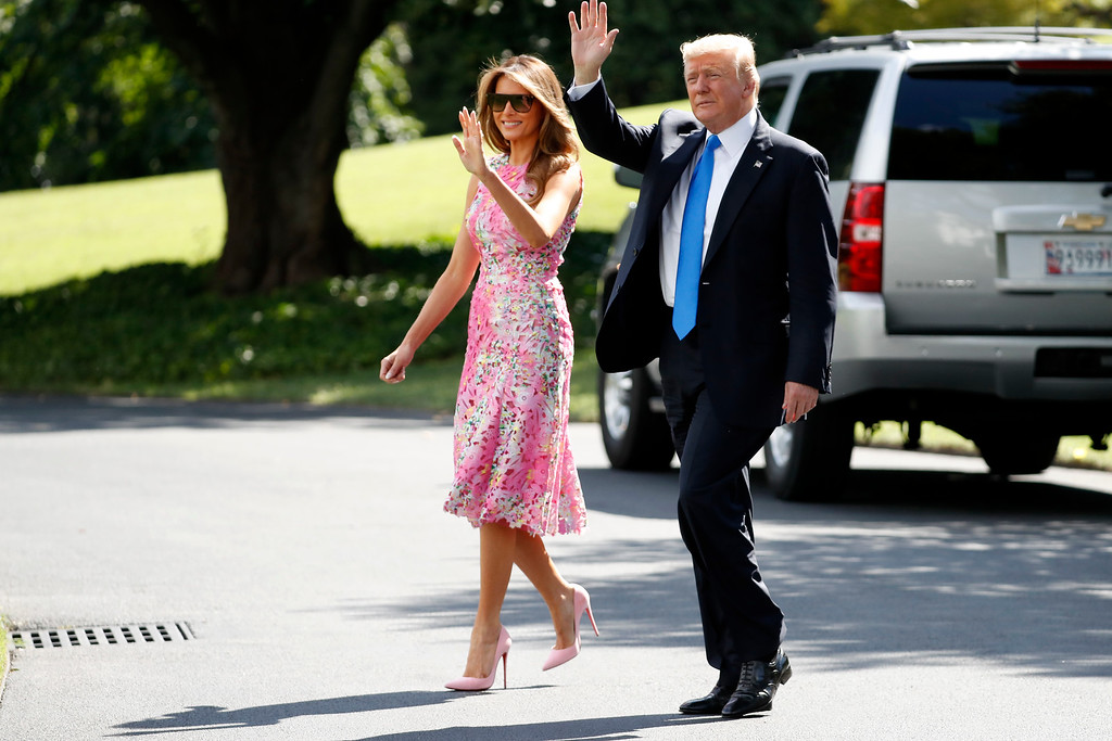 . President Donald Trump waves as he walks with first lady Melania Trump to Marine One on the South Lawn of the White House in Washington, Tuesday, July 25, 2017, for a short trip to Andrews Air Force Base, Md. then onto Ohio. (AP Photo/Alex Brandon)