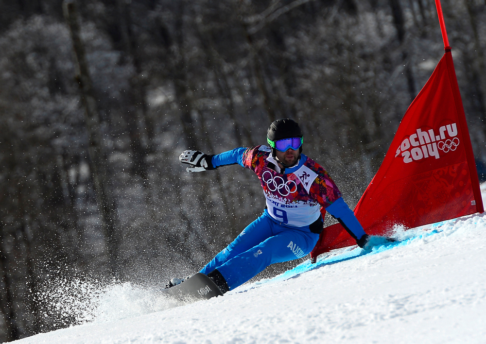 . Austria\'s Andreas Prommegger competes in the Men\'s Snowboard Parallel Giant Slalom 1/8 Finals at the Rosa Khutor Extreme Park during the Sochi Winter Olympics on February 19, 2014.  JAVIER SORIANO/AFP/Getty Images