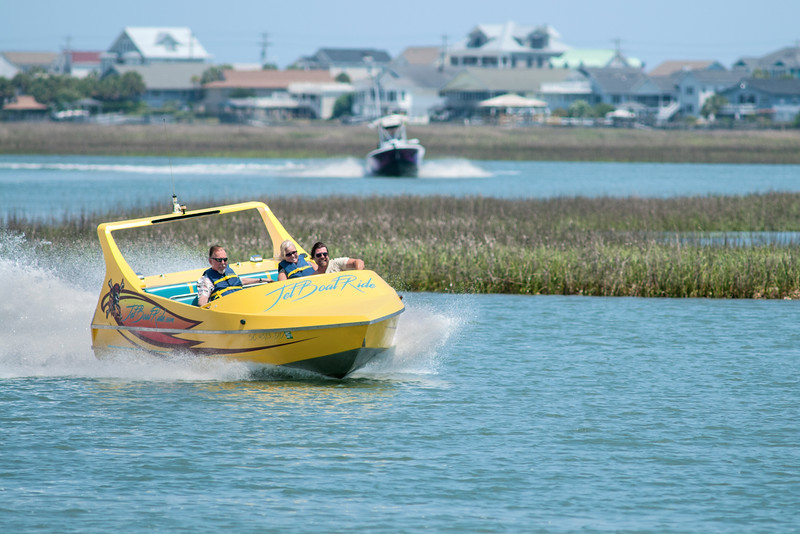 A high-powered tourist boat plows through the water near The Marshwalk in Murrells Inlet, SC on Thursday, May 12, 2016. Copyright 2016 Jason Barnette