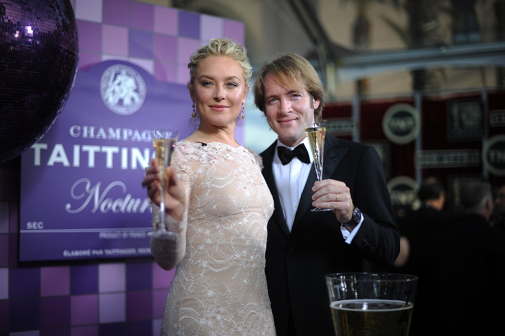 . Elisabeth Rohm and Clovis Taittinger kick of the show with a toast on the red carpet at the 20th Annual Screen Actors Guild Awards  at the Shrine Auditorium in Los Angeles, California on Saturday January 18, 2014 (Photo by Hans Gutknecht / Los Angeles Daily News)