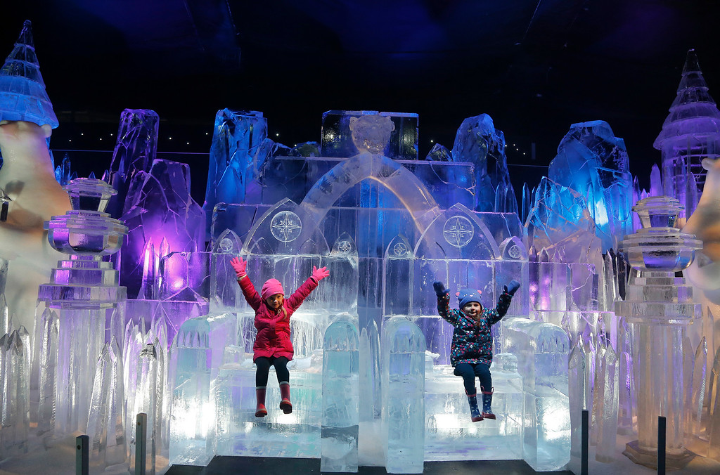 . 4 year old Scarlett, left, and 3 year old Zoe enjoy sitting on a Throne of the castle ice sculpture at the launch of Hyde Park Winter Wonderland\'s Magical Ice Kingdom in London, Thursday, Nov. 17, 2016. This year\'s Winter Wonderland starts on Nov. 18, 2016 until Jan. 2, 2017. (AP Photo/Frank Augstein)