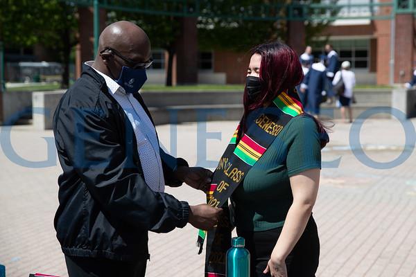 Sankofa Graduates Pick up Kente Stoles