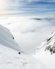 Above a sea of clouds. Winter alpine climb on Mt. Sir Douglas, South-East Face IV, 5.6. Kananaskis, Alberta.