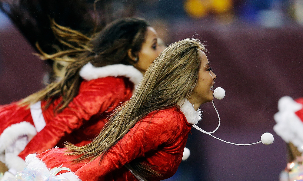 . LANDOVER, MD - DECEMBER 09:  Members of the Washington Redskins cheerleaders preform during the fourth quarter of the Redskins and Baltimore Ravens game at FedExField on December 9, 2012 in Landover, Maryland.  (Photo by Rob Carr/Getty Images)
