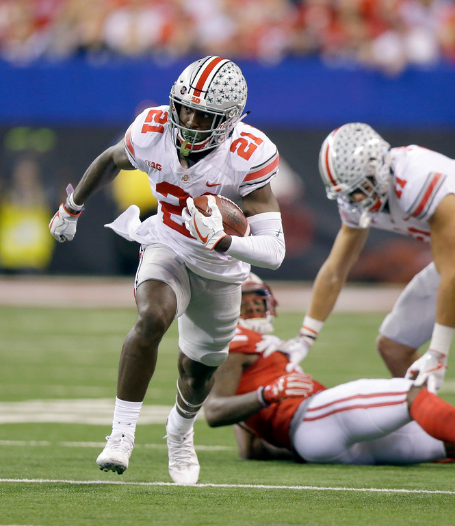 . Ohio State wide receiver Parris Campbell runs with the ball during the first half of the Big Ten championship NCAA college football game against Wisconsin, Saturday, Dec. 2, 2017, in Indianapolis. (AP Photo/Michael Conroy)