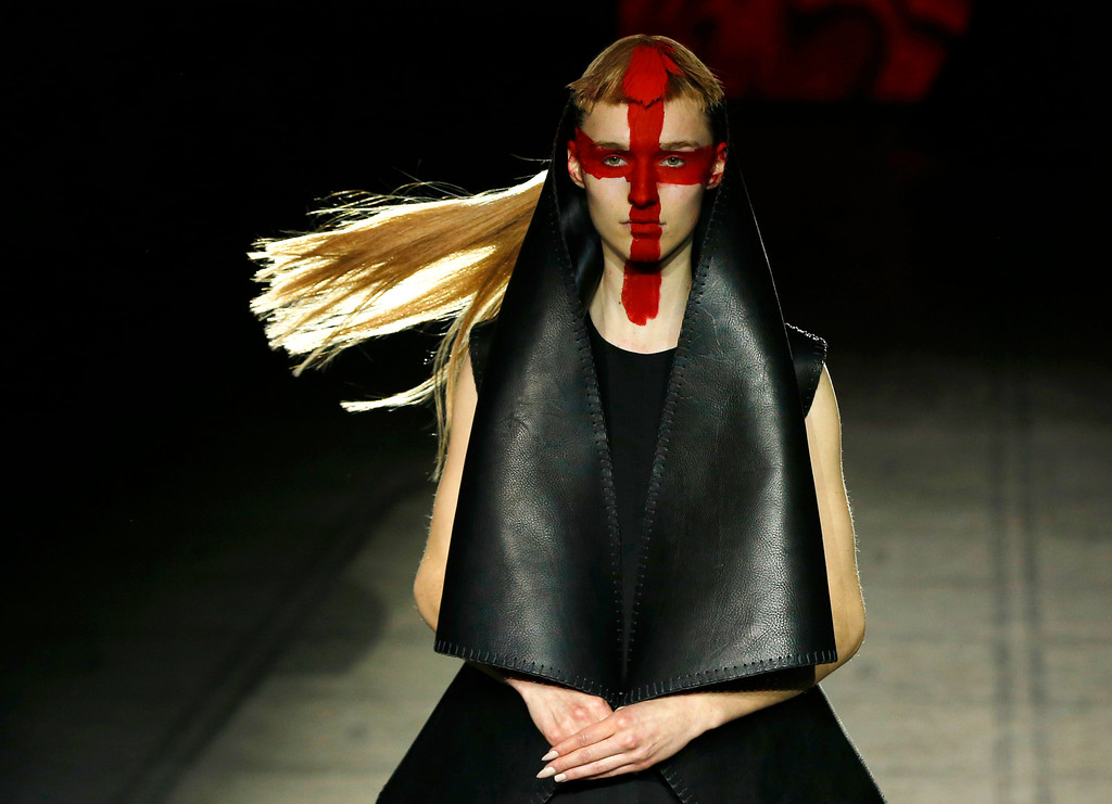 . FILE - In this Saturday Feb. 21, 2015 file photo, a model wears an outfit by designer Gareth Pugh during his Autumn/Winter 2015 show at London Fashion Week, in London. (AP Photo/Alastair Grant, File)