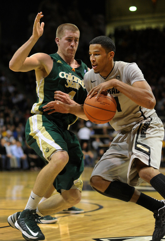 . Buffs guard Andre Roberson, (21) drove to the basket on Rams forward Pierce Hornung (4) in the first half. The University of Colorado men\'s basketball team hosted Colorado State University inside the Coors Events Center Wednesday night, November 5, 2012. Karl Gehring/The Denver Post