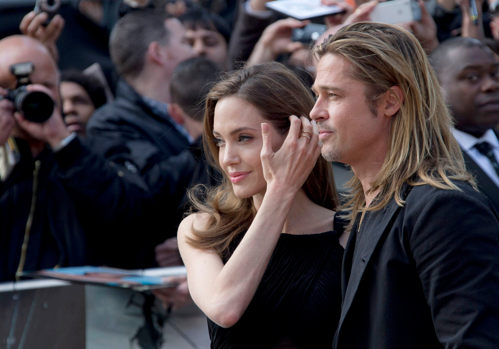 . Brad Pitt and Angelina Jolie arrive for the World Premiere of World War Z at a central London cinema, Sunday, June 2, 2013. (Photo by Joel Ryan/Invision/AP)