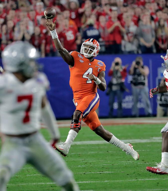. Clemson quarterback Deshaun Watson (4) throws against Ohio State during the first half of the Fiesta Bowl NCAA college football game, Saturday, Dec. 31, 2016, in Glendale, Ariz. (AP Photo/Rick Scuteri)