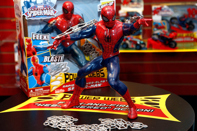 . Hasbroís new POWER WEBS RAPID FIRE WEB BLAST SPIDER-MAN, standing at over 12-inches tall and featuring kid-powered, rapid-fire, web-shooting action, is displayed in Hasbroís showroom at the American International Toy Fair, Saturday, Feb. 9, 2013, in New York. (Photo by Jason DeCrow/Invision for Hasbro/AP Images)