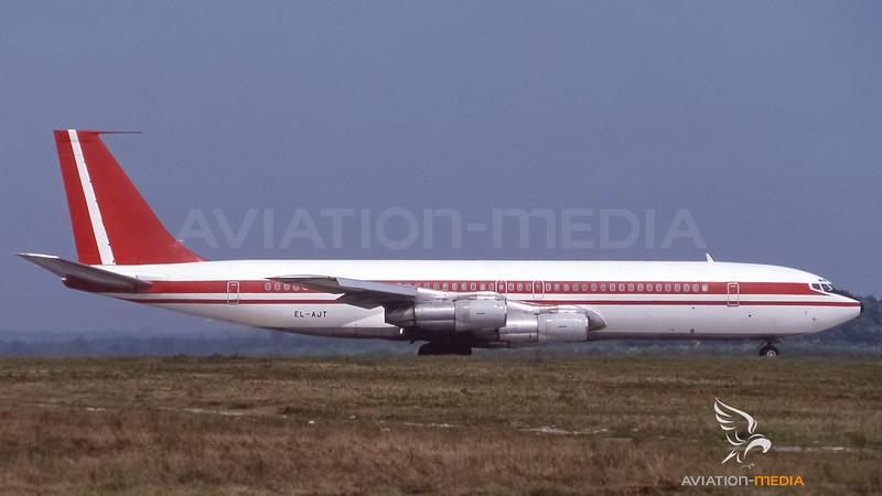 Omega Air Gambia_B707_EL-AJT_basic Air Mauritius cs_MXP_19890900_Ground_sun_0116-019_AM.jpg
