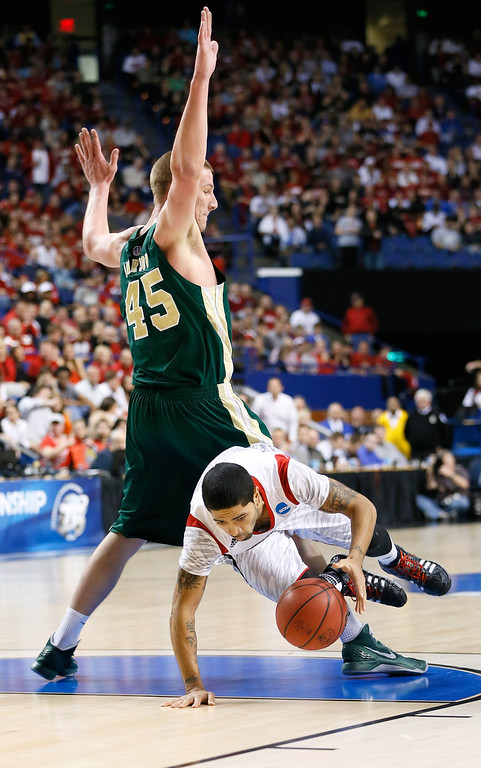 . LEXINGTON, KY - MARCH 23: Peyton Siva #3 of the Louisville Cardinals falls trying to dribble around Colton Iverson #45 of the Colorado State Rams in the first half during the third round of the 2013 NCAA Men\'s Basketball Tournament at Rupp Arena on March 23, 2013 in Lexington, Kentucky.  (Photo by Kevin C. Cox/Getty Images)