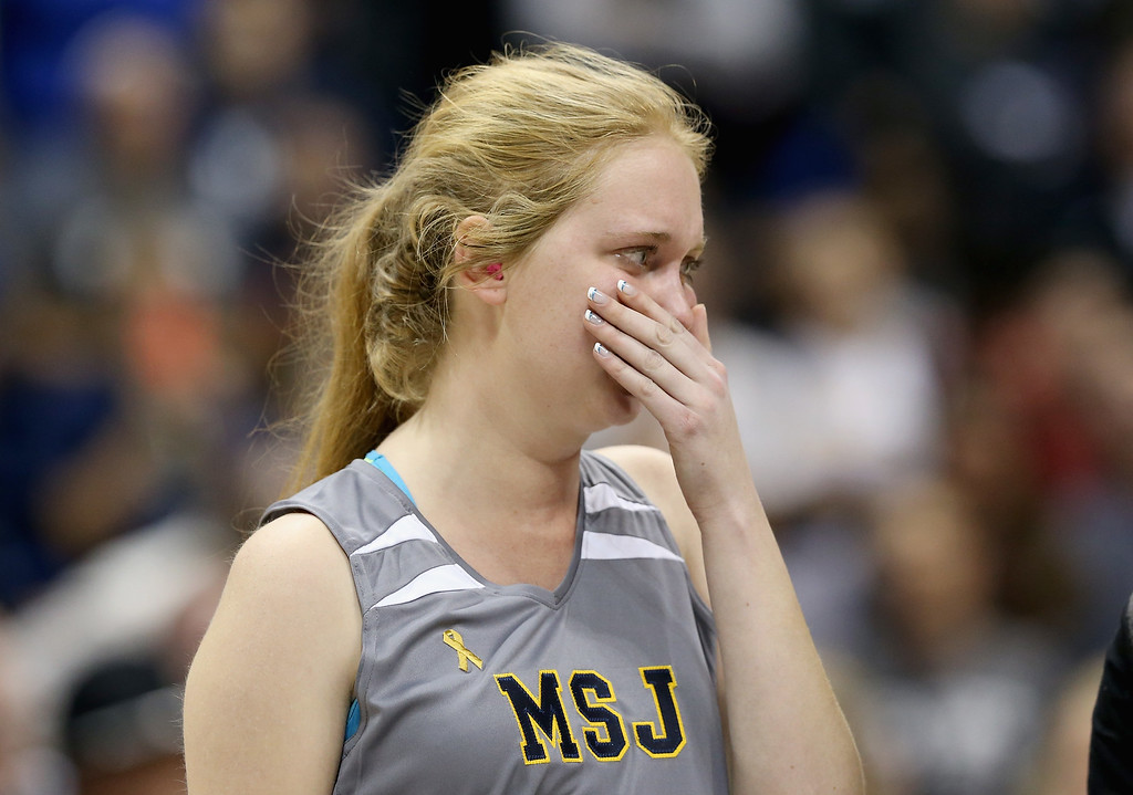 . Lauren Hill of Mount St. Joseph wipes away tears during an awards ceremony following the game against Hiram at Cintas Center on November 2, 2014 in Cincinnati, Ohio. Hill, a freshman, has terminal cancer and this game was granted a special waiver by the NCAA to start the season early so she could play in a game.  (Photo by Andy Lyons/Getty Images)