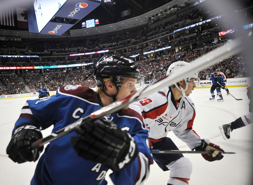 . Colorado Avalanche forward Gabriel Landeskog chases after the puck against the Washington Capitals\' Nicklas Backstrom in the first period.   (Photo By Patrick Traylor/The Denver Post)
