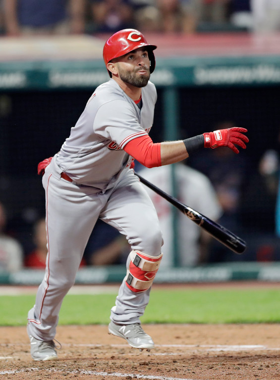 . Cincinnati Reds\' Jose Peraza watches his RBI-single off Cleveland Indians relief pitcher Cody Allen during the ninth inning of a baseball game Tuesday, July 10, 2018, in Cleveland. The Reds won 7-4. (AP Photo/Tony Dejak)