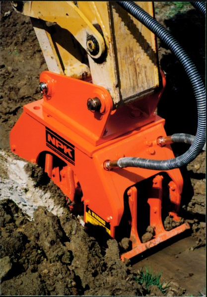 NPK C4C compactor with narrow baseplate on backhoe at NPKCE (7).JPG